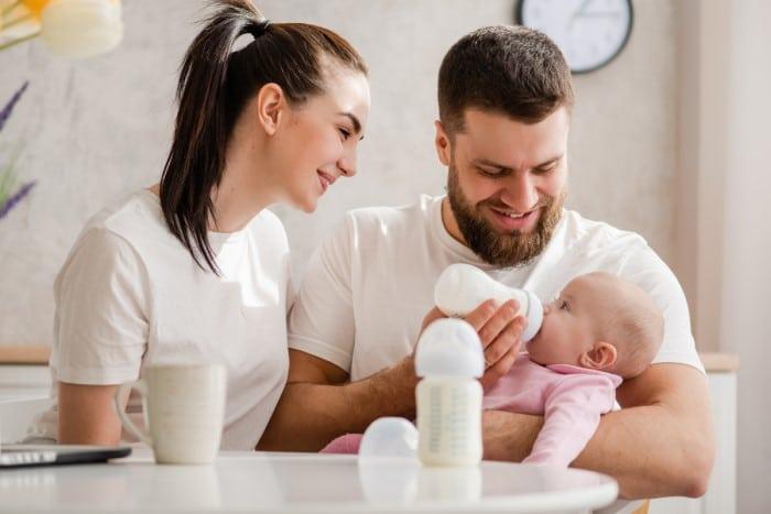 Mom n Dad feeding Baby with Baby Formula
